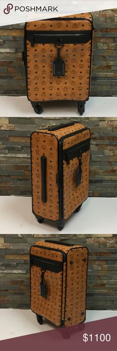 """MCM Trolley Check In Medium Suitcase Up for sale is a preowned  MCM Trolley Check In Medium Suitcase in very good condition with no major wear but showing minor signs of prior use. The is some scratch marks on the plastic near the extendable handle is located. There is also a rub mark on one corner as shown in the photos.  Others then that the suitcase is in excellent shape. Measures 21"""" x 15"""" x 7"""". Authentic.  No trades MCM Bags Travel Bags"""