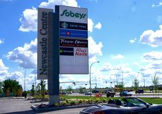 Newcastle Centre in Edmonton, AB. 33' High Multi-tenant Pylon display for a shopping centre.