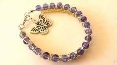 Very pretty blue & yellow goddess bracelet with butterfly charm - The Supermums Craft Fair
