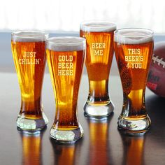 """""""cold beer here"""" pilsner glasses w/ funny beer related phrases engraved on them."""