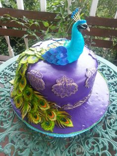 My labor of love for my mother's 75th birthday. Peacock Cake.  Inside is red velvet with a middle layer of cheesecake & iced with white chocolate buttercream.