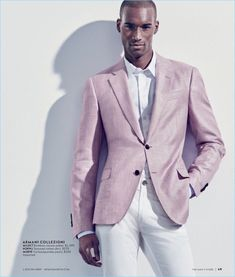 Corey Baptiste dons a pink and white look from Armani Collezioni.