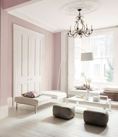 Gray lilac people walls acts as both a color and neutral at the same time. This living room is so airy it is almost ethereal