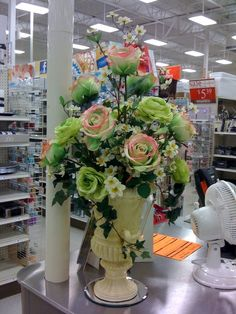 Love the vase style, make it yellow and love the flower placement, but the COLORS HAVE GOT TO GO! Floral arrangement