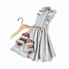 Perfect pairings! The perfect summertime outfit for little girls. This beautiful dress from Remie Girl is SO soft and comfortable and pairs perfectly with these handcrafted Adelisa & Co. leather sandals for girls. Shop small, leather sandals, little girl dresses, toddler summer style, capsule wardrobe.