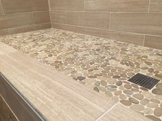 Sliced java tan pebble tile shower floor.   https://www.pebbletileshop.com/gallery/Sliced-Java-Tan-Pebble-Tile-Shower-Floor.html#.VaQGMPlViko