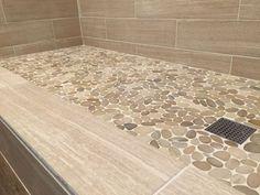 Sliced java tan pebble tile shower floor. https://www.pebbletileshop.com/gallery/Sliced-Java-Tan-Pebble-Tile-Shower-Floor.html#.VaQGMPlViko