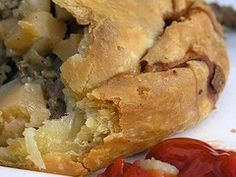 Homemade Beef Pastry. (I'm from WI and I have never heard of having them with chili sauce. They are mainly found in the UP of Michigan or Northern WI and covered in brown gravy. I would omit the suet and us ground round.)