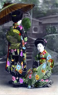 Two Hangyoku with Bangasa 1910 This is a hand-colored postcard from around 1910, showing two Hangyoku (Young Geisha) holding paper umbrellas. --------- #japan #japanese
