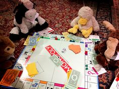 Photo Idea - Stuffed Animal Sleepover | What board game do stuffed animals love to play? Monopoly!