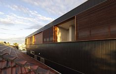 Exterior of the Plywood House combines ample ventilation with private quarters - Decoist