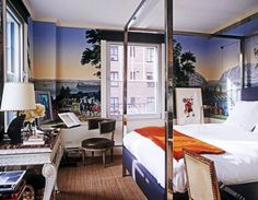 Add a nice landscape scene in your urban bedroom using Zuber Wallpaper and Chrome Canopy Bed