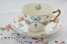 Crown Staffordshire England tea cup and saucer / gold gilding/ pink roses/ blue ribbon/ bows by VieuxCharmes on Etsy