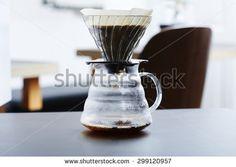 Fresh coffee percolating into glass