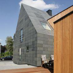 Einfamilienhaus in Symmetrischer Deckung von Rathscheck Schiefer