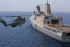 AT SEA (Aug. 04, 2014) A U.S. Marine Corps CH-53E Super Stallion helicopter with Marine Medium Tiltrotor Squadron (VMM) 263 (Reinforced), 22nd Marine Expeditionary Unit (MEU), prepares to land aboard the amphibious transport dock ship USS the Mesa Verde (LPD 19). (U.S. Marine Corps photo by Cpl. Manuel A. Estrada/Released)