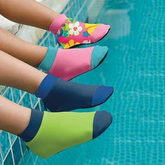 Sun Smarties Kids Water Socks --- Prevents slips, scrapes, sunburn, and blisters, with these baby and kids' UV swim socks! These non-skid aqua socks protect tender soles and little toes, on land and in water. The slip-resistant sole offers superior traction to both walkers and crawlers, while the UPF 50+ fabric shields the tops of the feet, an area prone to sunburn. Lightweight and comfortable, even when wet. Machine washable.