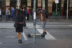I like the colour matching of the two people that gives them a connection even though they were both alone. I like the composition of the photo and it looks like the woman was checking the male on the skateboard out and I thought it gave the image a bit of humour