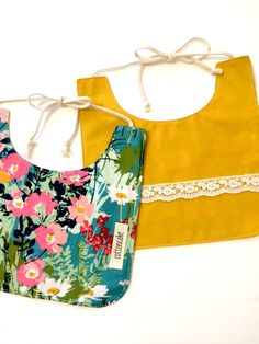 Reversible floral mustard bib by cottoncakeshop on Etsy
