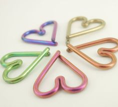 This hand crafted 16 gauge Niobium heart will fit your piercing perfectly! It measures 12mm in total width, but the inside diameter loops of the
