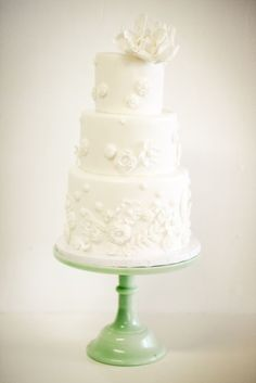 I love the green cake stand with the white cake!