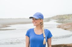 Your activities take you outside, but your needs are simple—a bit of sun protection, some shade for your eyes, something to keep the sweat at bay, and a way to keep the hair in check. Ladies, the Pursuit Cap is for you. We added some high-visibility retroreflective safety details for those early morning runs and late-night dog walks. www.sundayafternoons.com