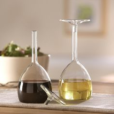 This is so awesome. Vinegar and Oil Bottles that look like wine glasses. Haha!