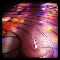 This photo, by @mzlatar, shows part of our indoor labyrinth highlighted by colorful light from the cathedral stained glass.