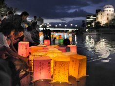 People release paper lanterns on the Motoyasu river opposite the Hiroshima Peace Memorial in remembrance of atomic bomb victims on the 67th anniversary of the bombing of the city.  Photograph: Kyodo/Japan