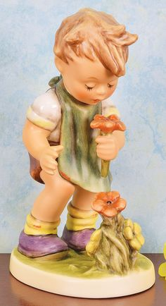 THE FLORIST HUMMEL FIGURINE  Poppies sure delight those who delight others, if you know what I mean?????