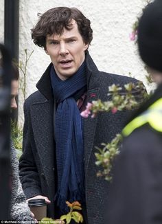 He's back!Benedict Cumberbatch was spotted back in the detective's familiar navy overcoat as he filmed the new series of Sherlock in Cardiff