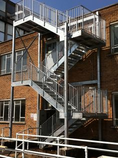Galvanised steel staircase with vertical infill bar balustrade to both sides.  Supplied and fitted by Morris Fabrications Ltd in London.