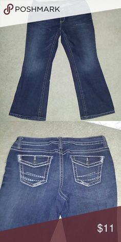 Boot cut blue jeans Stretch fit blue jeans buttoned back pockets. a new approach Jeans Boot Cut