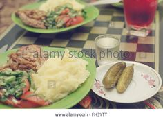 Download this stock image: Salt cucumbers, potato, fried meat, salad from fresh cucumbers and tomatoes. Very delicious food on the plate. - FH3YTT from Alamy's library of millions of high resolution stock photos, illustrations and vectors.