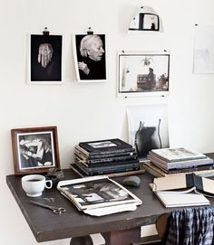Effortless art: Hang favorite photos with binder clips and pushpins.