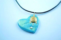 Honu polymer clay heart with Sterling plated sea turtle and genuine freshwater pearl.  by Eleksmom.