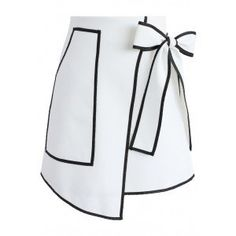 If you're going to do black and white, you may as well keep it saucy and fun! This Urban Vogue flap skirt offers up black trimmings and a self-tie bow upon the waist that makes it an edgy yet endearing look. - Self-tie bow on waist - Pocket on one side - Concealed back zip closure - Lined - 100% Polyester - Hand wash Size(cm)Length  Waist XS       46      64 S        47      68       M        48      72 Size(inch) Length  Waist  XS      ...