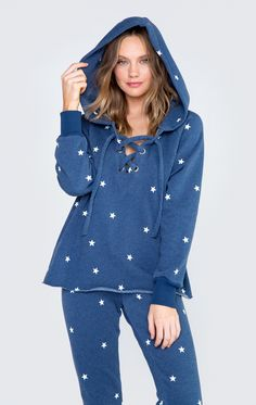 We are all made of stars in our Football Star Hutton Sweater. This sweatshirt features a comfy hood, a sultry front lace-up detail and a raw hem.  In After Midnight Navy and Warm Cement. 70% Cotton, 30% Polyester Model wears a size small