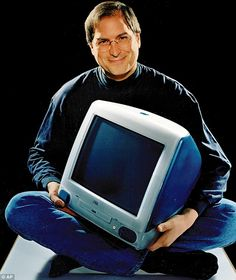 Revealed: The Apple computer prototypes from the early 1980s which were the forerunners of today's iPads and MacBooks. This 1998 file photo provided by Apple shows Apple CEO Steve Jobs holding an iMac computer.