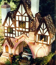 """Former Third-Place Winner Susan Palmer of O'Fallon, IL, decorated her house with Beef Jerky Tudor trim, bubblegum bricks, and sugar-cookie shingles. Palmer, a computer programmer, completed this gingerbread house in three months. But it took her husband and three kids only a couple of days to voice their opinions. """"They banished me to the dining room, because they didn't want gingerbread taking over!"""" she recalls. One distinguishing element of this house is the brickwork — compiled of 7 1/2…"""