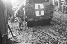 Soldiers and medical personnel carrier M3A1 4th Armored Division US field hospital in the Belgian town Assenua (Assenois, three kilometers west of Leglise).