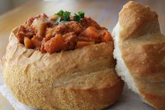 Bunny chow, often referred to as a Bunny is a South African fast food dish consisting of a hollowed out loaf of bread filled with curry, that originated in Durban. Bunny chow is also called a kota in many parts of South Africa. South African Recipes, Indian Food Recipes, Indian Foods, South African Bunny Chow, Kos, Ma Baker, Food Terms, Best Street Food, Pasta