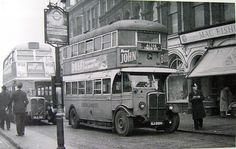 LGOC Bus stop cast ductile iron post with illuminated double sided Flag, at LONDON BRIDGE on Railway Approach in 1950.  Nothing new TfL later introduced solar PV powered LED illuminated Flags again in 2000, refurbishing 3,500 Bus stop until 2008.