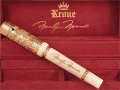 gold pen with Monroe's signature -  Year? By Krone    The pen contains a small sample of Marilyn's lipstick and a small image of her that can be viewed from a small window in the cap
