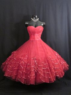 Description  An absolutely stunning 1950's party/prom dress in stop-the-traffic red tulle with striking metallic gold accents ! What a statement