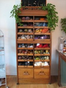 What a lovely way to store and display yarn!