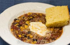 """slow cooker taco soup the only changes I made was using ground beef, and making my own """"taco seasoning"""" which I found on the internet & I did drain the whole corn. I served it on top of a bed of cut up lettuce and added fancy cut mexican cheese & sour cream over the top of it and then sprinkled it with crushed white corn chips... we loved it ! oh & serving with cornbread was great too!"""