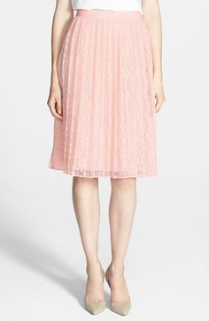 The lace adds a touch of romance to this sweet pleated skirt
