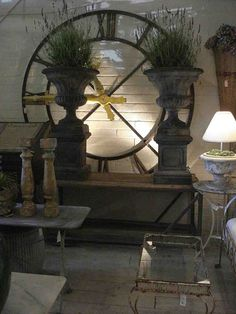 giant backlit clock; stone urns with lavender