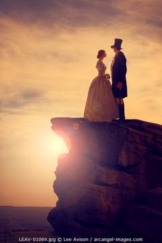 www.arcangel.com - victorian-couple-on-a-rock-outcrop-at-sunset